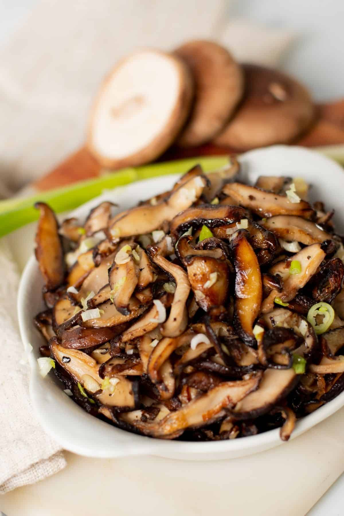 sautéed shiitake mushrooms in a small white bowl