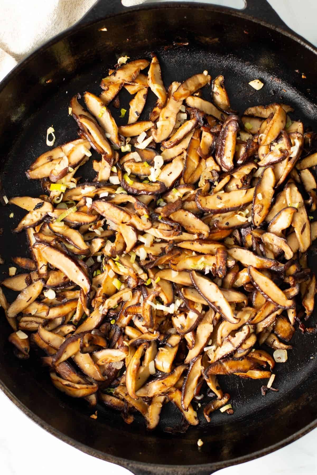 shiitake mushrooms recipe cooking in a cast iron skillet