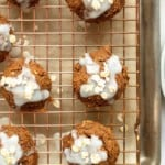 pumpkin oatmeal cookies topped with glaze and rolled oats