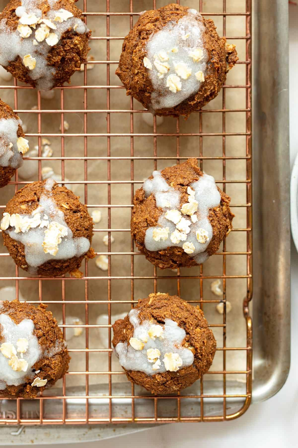 pumpkin oatmeal cookies topped with glaze and rolled oats - healthy pumpkin desserts
