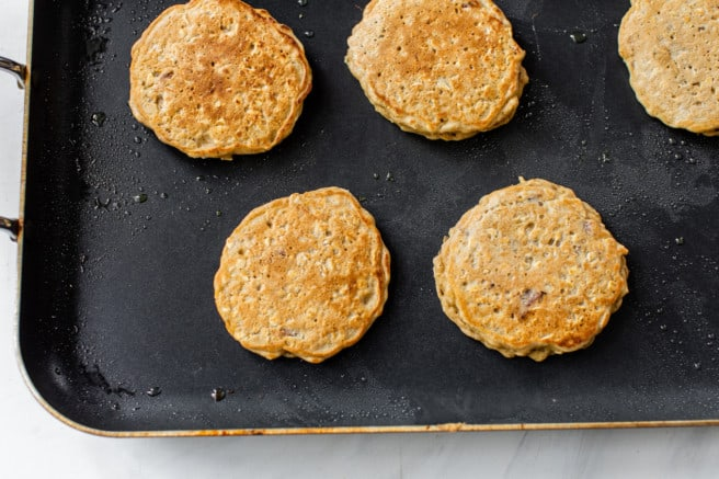 oatmeal pancakes cooking on skillet