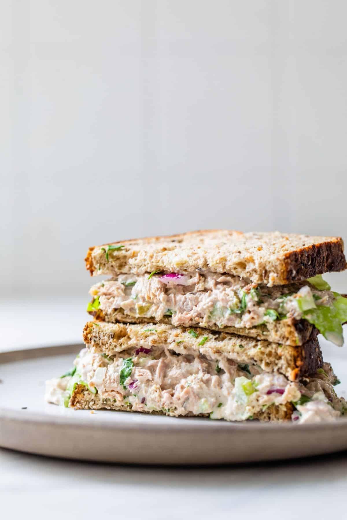 tuna salad sandwich served on a small white plate