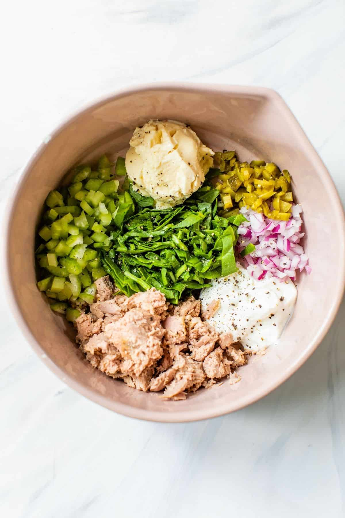 ingredients for tuna salad added to a large bowl