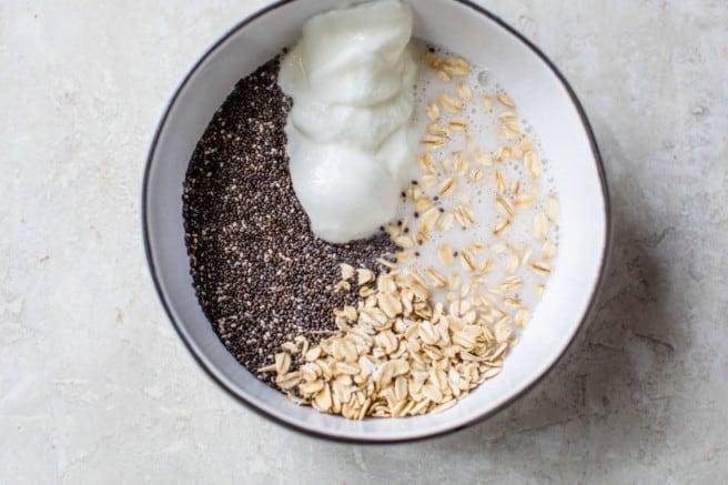 mixing Greek yogurt and chia seeds with oats