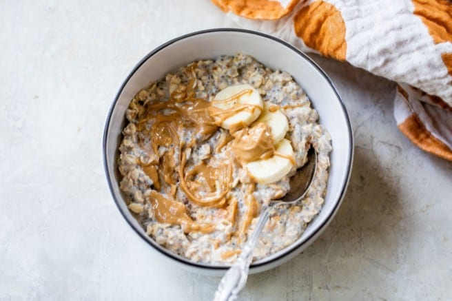 overnight oats topped with banana slices and peanut butter